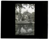 [Unidentified residence near a body of water] [graphic].