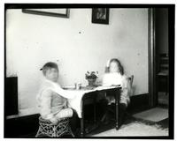 [Elliston P. Morris, Jr. and Marriott C. Morris, Jr. at small table set for a meal] [graphic].