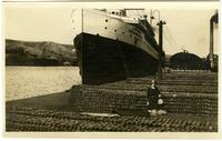 Janet Morris on dock with copper ingots, S.S. Octorara, Great Lakes Trans. Co., Buffalo, NY [graphic].