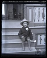 Lily boy on front steps at Sea Girt [graphic].
