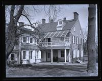 Our house, from magnolia tree (mag. grandiflora), Mother & Anna Rhoads in porch, [Deshler-Morris House, 5442 Germantown Avenue] [graphic].
