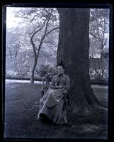 Portrait of Bessie, sitting under elm in centre of yard, [Deshler-Morris House, 5442 Germantown Avenue] [graphic].