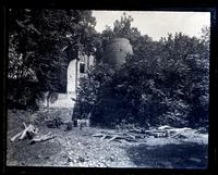 Old blast furnace at Allaire, [NJ]. A[nna] P. Sharpless in foreground [graphic].