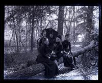 Group on fallen tree. Bartram's Garden. Mrs Shoemaker, Bird & Minnie Tyson Shoemaker, Minnie Kimber & Bess [graphic].