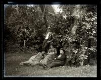 Group at Allaire. In meadow. Caspar, Carrie, Father & Bess. [NJ] [graphic].