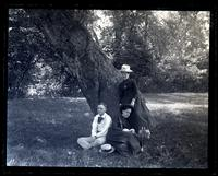 Group at foot of great elm tree in valley Allaire, [NJ]. Anna Sharpless, Lena Goodwin & G[eorge] V[aux], Jr. [graphic].
