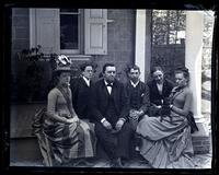 [Group on porch at Deshler-Morris House, 4782 Main St., Germantown. Lily Ellicott, Marriott Canby, Father, Geo. S. Morris, Geo Vaux, Jr. & Bess] [graphic].