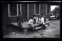 [Elliston Perot Morris Jr. and Marriott Canby Morris Jr. playing on a porch], Pocono Lake, [PA]