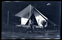 [Marriott Canby Morris Jr. and Elliston Perot Morris Jr. outside a tent], Pocono Lake, [PA] [graphic].