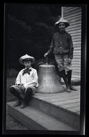[Marriott Canby Morris Jr. and Elliston Perot Morris Jr. with a large bell], Pocono Lake, [PA] [graphic].