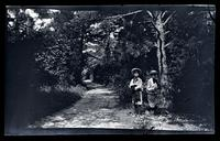 [Marriott Canby Morris Jr. and Elliston Perot Morris Jr. on a path], Sea Girt, NJ [graphic].
