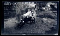 [Elliston Perot Morris, Jr. and Marriott Canby Morris, Jr. riding a cart], Germantown [graphic].