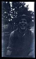 [Portrait of a laughing man], canoeing, Egg Harbor River, NJ [graphic].