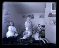 [Interior of a playroom with Elliston P. Morris, Jr. on a rocking horse and Marriott C. Morris, Jr. seated on a chair] [graphic].