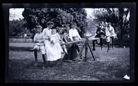 Group on see saw, Meadow Farm, [including Jane Rhoads Morris and Marriott Canby Morris Jr. Darlington, MD] [graphic].
