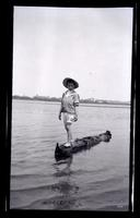 [Marriott Canby Morris Jr. standing on log in water, Sea Girt] [graphic].