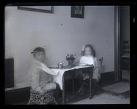 [Marriott C. Morris, Jr. and Elliston P. Morris, Jr. at small table set for a meal] [graphic].