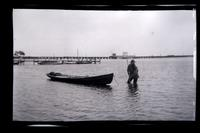[Man in water pulling boat, Wreck Pond, Sea Girt, NJ] [graphic].