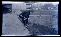 [Boy with rake, 131 W. Walnut Lane] [graphic].