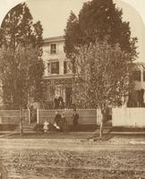 [Family posed in front of clapboard house] [graphic]
