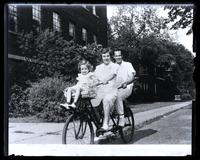M[arriott] C[anby, Jr.], Libby & Ruth on tandem bicycle, Madison, Wisconsin [graphic].
