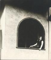 [Unidentified woman sitting on windowsill] [graphic].