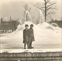[Two boys in front of the Swann Memorial Fountain in Logan Circle in winter.] [graphic].