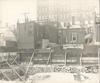 [Stone foundation at construction site and rear of row houses, Philadelphia] [graphic].