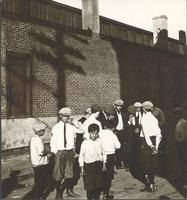 [Young men in front of shadowed brick wall, unidentified location] [graphic].