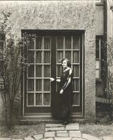 [Unidentified woman standing in front of French doors] [graphic].