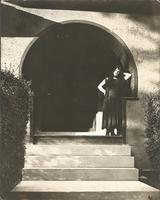 [Unidentified woman standing in arched doorway] [graphic].