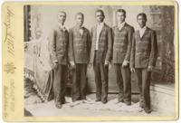 [Portrait of five African American men attired in uniforms, probably band uniforms] [graphic] / Harry A. Webb, 112 & 114 Nth. 9th St. Philadelphia, Pa.