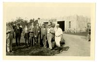 Group standing in front of a garage