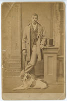 [Unidentified African American man with a dog]