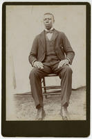 [Well-dressed unidentified African American man]