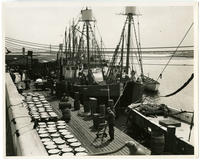[Dock workers transporting ice on a pier in Philadelphia]