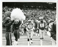 [Philadelphia Eagles football players Edward Herman, Dennis Harrison, and Woody Peoples entering the field at Veterans Stadium, Philadelphia]