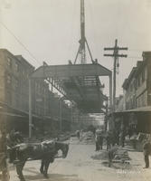 Progress of steel construction in Front St. at bent #40 looking south, May 1, 1916.