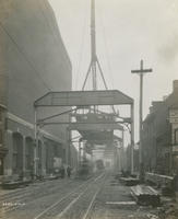 Progress of steel construction in Front St. at bent #57 looking south, May 16, 1916.