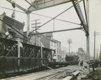 Progress of steel construction in Front St. at bent #85, looking north showing crosswires, June 12, 1916.