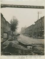 Progress of steel construction in Front St. at bent 99, looking north, showing crosswires, June 19, 1916.
