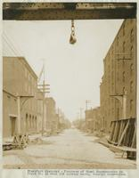 Progress of steel construction in Front St. at bent 108, looking north, showing crosswires, June 26, 1916.
