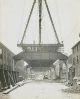 Progress of steel construction in Front St. at bent #108, looking south, June 26, 1916.