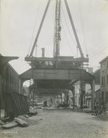 Progress of steel construction in Front St. at bent 108, looking south, July 3, 1916.