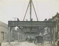 Progress of steel construction in Front St. at bent #121, looking south, July 31, 1916.