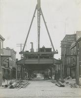 Progress of steel construction, looking south on Front St. from bent 137, August 7, 1916.