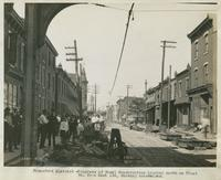 Progress of steel construction, looking north on Front St. from bent 155, showing crosswires, August 14, 1916.