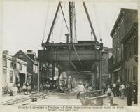 Progress of steel construction, looking south on Front St. from Bent 155, August 14, 1916.