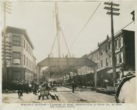 Progress of steel construction in Front St. at bent 211, looking south, September 18, 1916.
