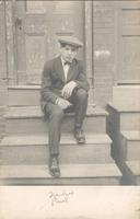 Young man sitting on stoop, Philadelphia.